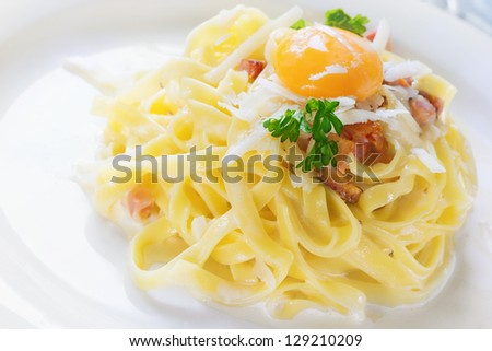 Pasta Carbonara - Tagliatelle with egg yolk, parsley and parmesan - stock photo