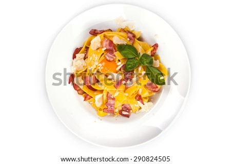 Pasta carbonara with tagliatelle spaghetti, egg yolk, bacon and basil ...