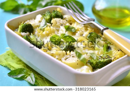 Pasta casserole with broccoli,cauliflower and cheese baked in bechamel sauce. - stock photo