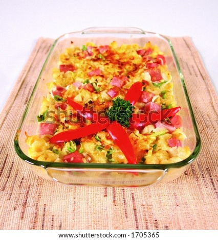 Pasta casserole with ham, green onions, tomato and onion