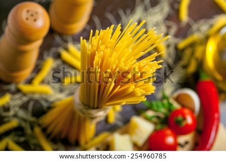 Pasta close-up, ingredients on table - stock photo