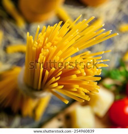 Pasta close-up shot, ingredients on background - stock photo