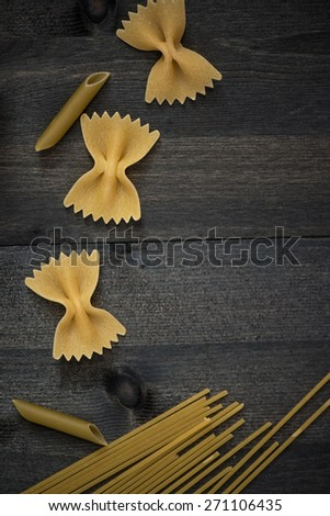 Pasta collection on rustic dark wooden background - stock photo