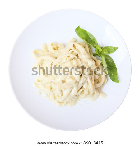 Pasta fettuccine with melted cheese on a white round dish isolated on a white background. Top view. - stock photo