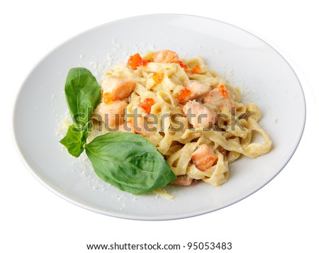 Pasta fettuccine with salmon and caviar on a white dish isolated on a white background. - stock photo