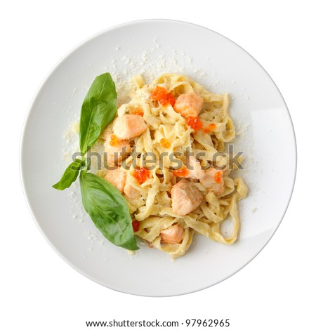 Pasta fettuccine with salmon and caviar on a white dish isolated on a white background. Top view. - stock photo