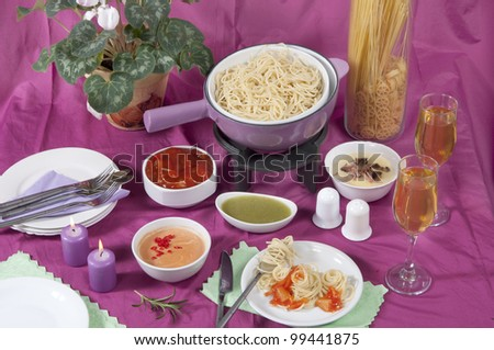 pasta  fondue with different sauces - stock photo