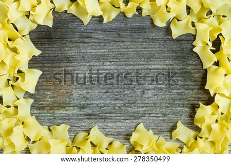 pasta frame over wood background - stock photo