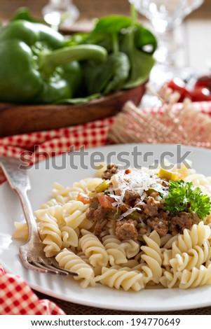 Pasta fusilli witn bolognese sauce and parmesan - stock photo