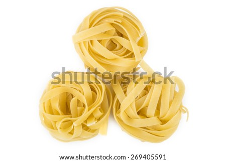 Pasta in form nest isolated on white background. Top view - stock photo