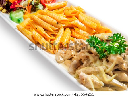 pasta in sauce, meat and vegetables in dish on white background - stock photo