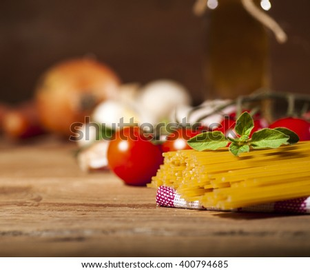 Pasta ingredients on old vintage wooden background. - stock photo