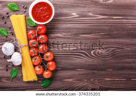 Pasta ingredients. tomato, garlic, pepper, ketchup  on wooden background. - stock photo