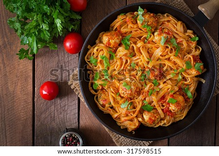 Pasta linguine with meatballs in tomato sauce. Top view - stock photo