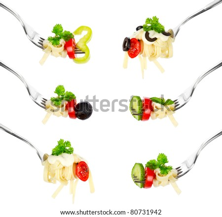 Pasta on a fork over white background - stock photo