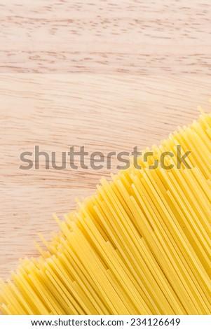 Pasta on wooden background - stock photo