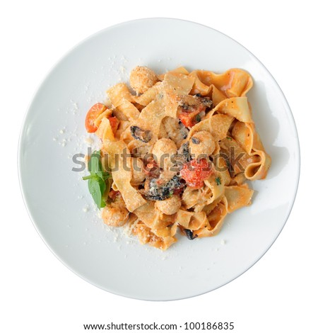 Pasta pappardelle with chicken noisettes and parmesan on white dish isolated on a white background. Top view. - stock photo
