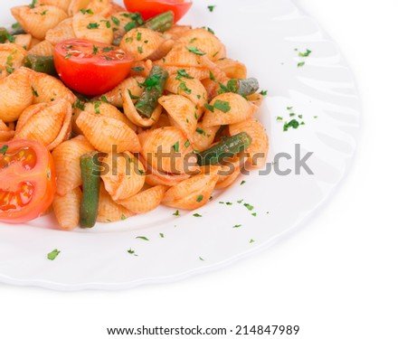 Pasta penne rigate with tomato sauce as haute cuisine. Whole background. - stock photo