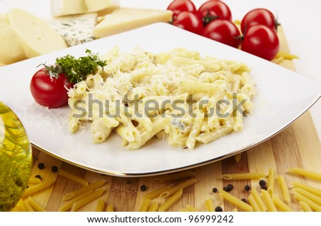 Pasta Penne under Parmesan Cheese - stock photo