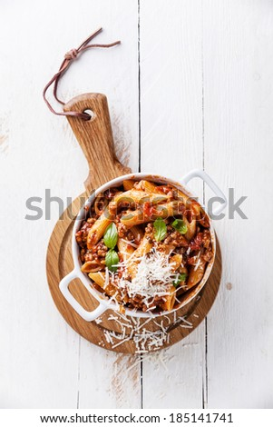 Pasta Penne with bolognese sauce and parmesan cheese - stock photo