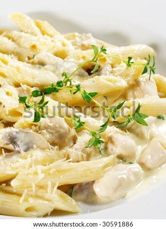 Pasta Penne with Chicken and Mushroom under Parmesan Cheese - stock photo
