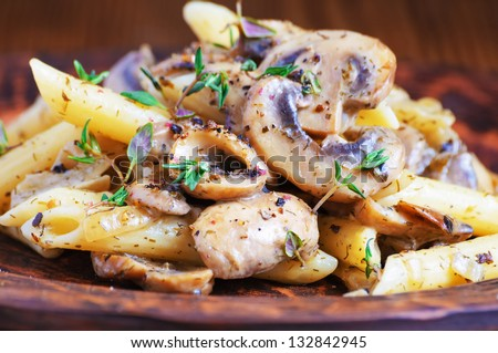 pasta penne with grilled mushrooms - stock photo