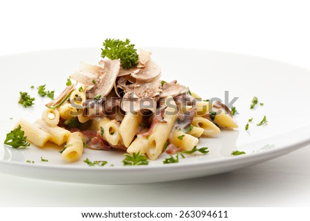 Pasta Penne with Mushrooms and Parmesan Cheese. Garnished with Parsley - stock photo