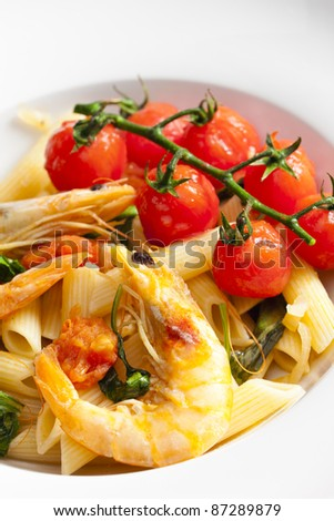 pasta penne with prawns, spinach and grilled cherry tomatoes