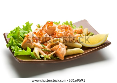 Pasta Penne with Salmon Slice and Red Caviar. Garnished on Salad Leaf with Cream Cheese Sauce and Lemon Slice - stock photo