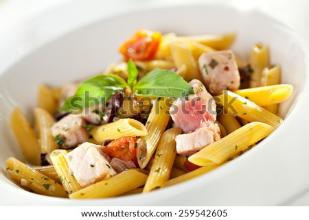 Pasta Penne with Tuna and Cherry Tomatoes - stock photo