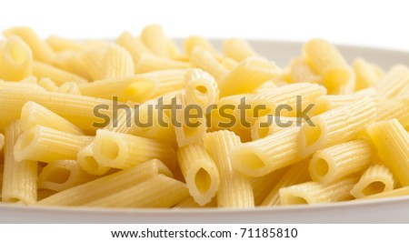 pasta plate on a white background, extreme closeup