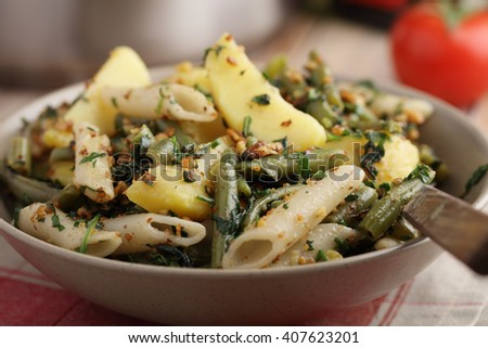 Pasta, potato, and green beans with pesto - stock photo
