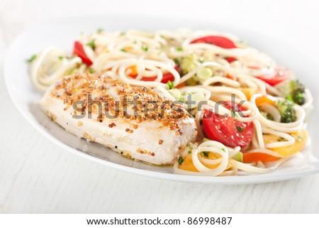 Pasta primavera and chicken breast in french mustard - stock photo