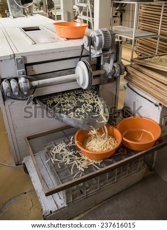 Pasta production line, pasta manufacturing - stock photo