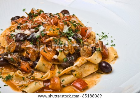 Pasta Puttanesca with olives, peppers, tomatoes and parsley