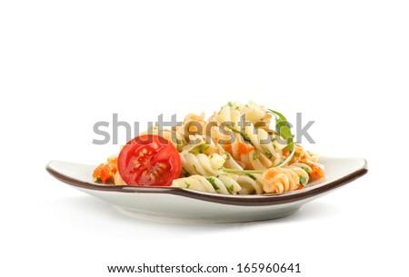 pasta radiatore with tomato sauce, basil and arugula - stock photo