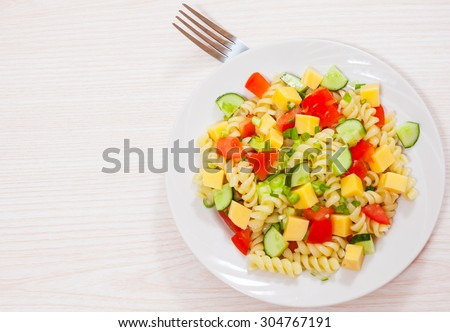 pasta salad with cheese and vegetables - stock photo