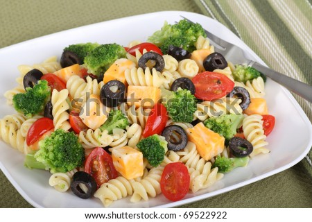 Pasta salad with cheese, tomatoes, black olives and broccoli - stock ...