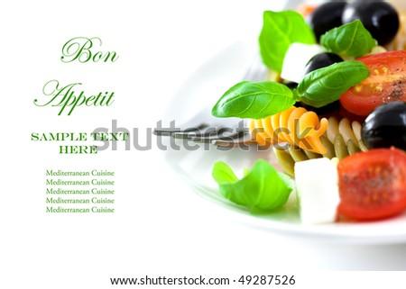 Pasta salad with feta and fresh basil - stock photo