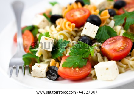 Pasta salad with feta and vegetables - stock photo