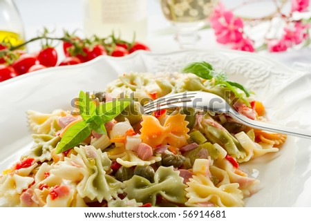 pasta salad with fork on dish