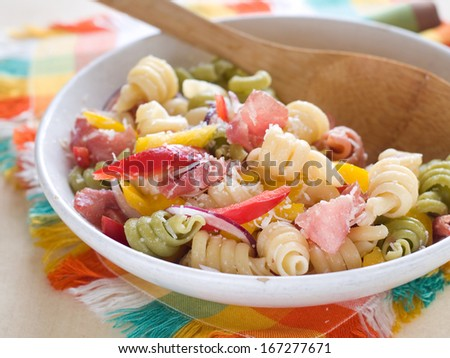 Pasta salad with ham, pepper and onion, selective focus - stock photo