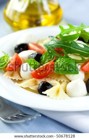 Pasta salad with mozzarella - stock photo