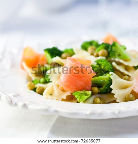 Pasta salad with salmon and green vegetables - stock photo