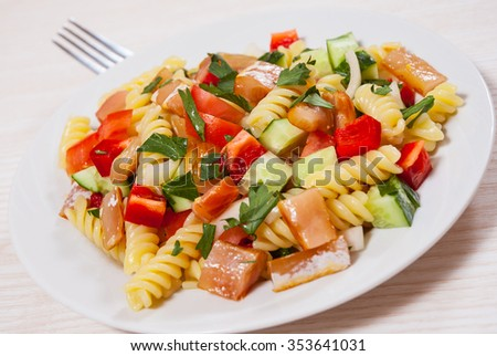 pasta salad with smoked salmon and vegetables - stock photo