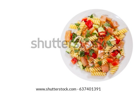 pasta salad with smoked salmon and vegetables. top view. isolated on white
