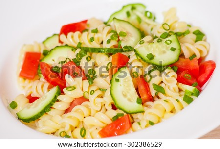 Pasta salad with tomato and cucumber - stock photo
