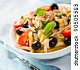 Pasta salad with tuna, olives and cherry tomatoes - stock photo
