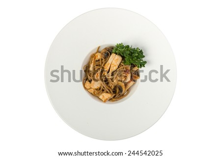 Pasta soba with chicken and mushrooms isolated on white background. Top view - stock photo