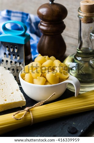 Pasta spaghetti, cheese, spices and oil,stone background - stock photo